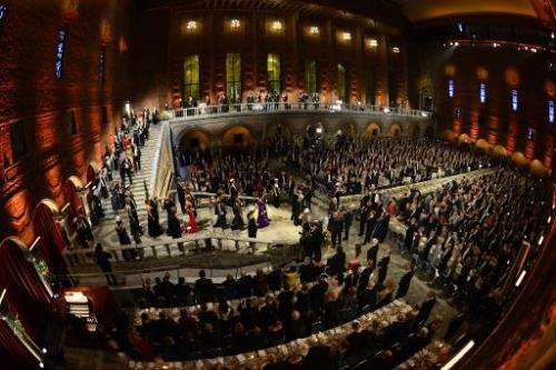 Guests arrive for the traditional Nobel Prize banquet at the Stockholm City Hall on December 10, 2013