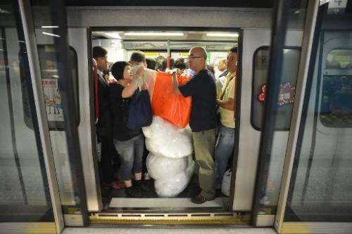 Hong Kong is pondering whether to rip out some seats from overcrowded metro trains to give the city's smartphone-addicted popula