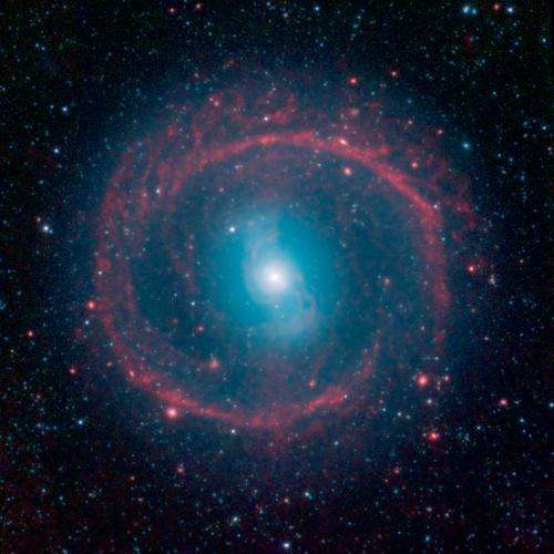 Image: Galactic wheel of life shines in infrared