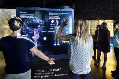 In an undated photo released by Micropia on September 30, 2014, visitors at the Micropia museum are scanned to check out their o