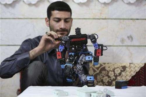 Iranian teacher builds robot to teach prayer