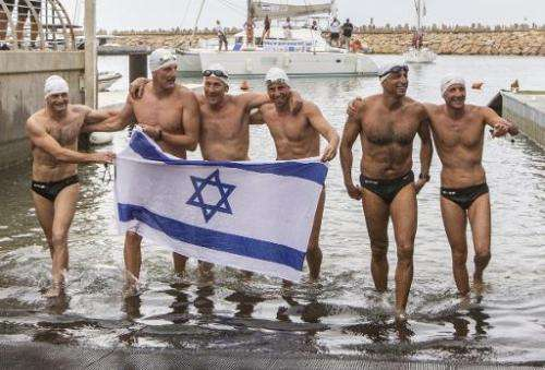 Israeli swimmers (from L to R) Ben Enosh, Luc Chetboun, Ud Erel, Ori Sela, Doron Amosi, Oded Rahav, celebrate after swimming fro