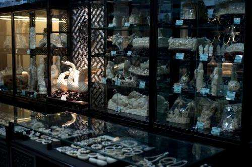 Ivory bracelets and ornaments are displayed at shop in Beijing on February 27, 2013