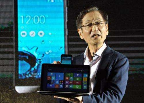 """Jonney Shih, the chairman of Taiwanese electronics company ASUS, introduces the company's new product called the """"ASUS Tran"""