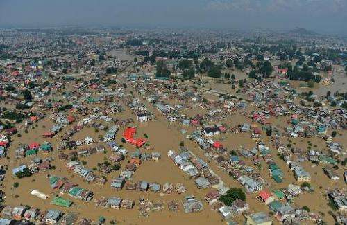 Kashmiri houses submerged by floodwater are seen from an Indian Air Force helicopter during rescue and relief operations in Dal