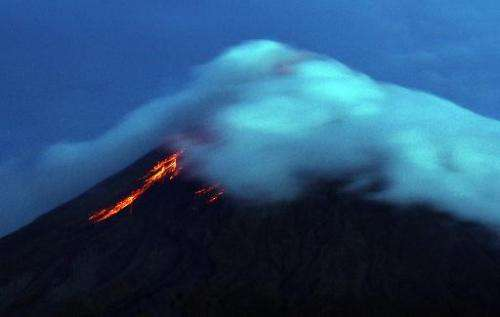 Lava flows from the crater of Mayon volcano, as seen from Legazpi City, Albay province, southeast of Manila, on September 17, 20