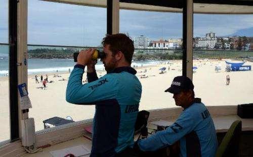 Lifeguards monitors surfers at Bondi Beach in Sydney on October 28, 2014