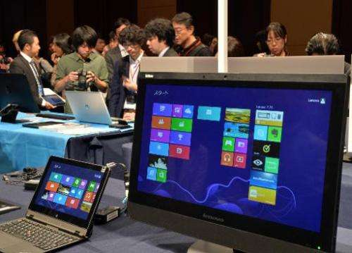 Microsoft pre-installed Windows 8.1 personal computers and tablets are displayed at a Windows 8.1 launch event in Tokyo on Octob