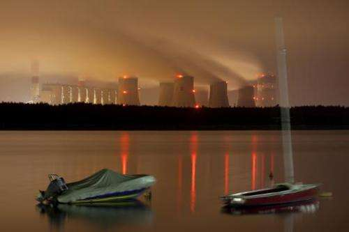 Night view of Poland's Belchatow coal-fired power plant on September 28, 2011. Poland may veto proposed EU greenhouse gas reduct