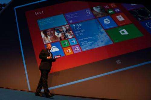 Nokia CEO Stephen Elop unveils the Nokia Lumia 2520 (displayed on the giant screen) during an event on October 22, 2013 in Abu D