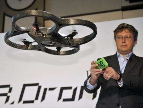 """Parrot CEO Henri Seydoux demonstrates the remote controlled toy helicopter """"AR.Drone"""", operated by smartphone, in Toky"""