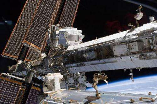 Particle detector finds hints of dark matter in space