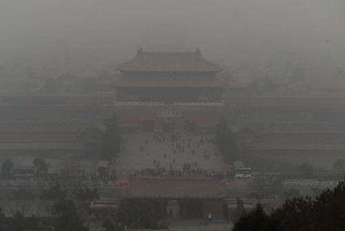 People visit the Forbidden City as heavy air pollution continues to shroud Beijing on February 26, 2014