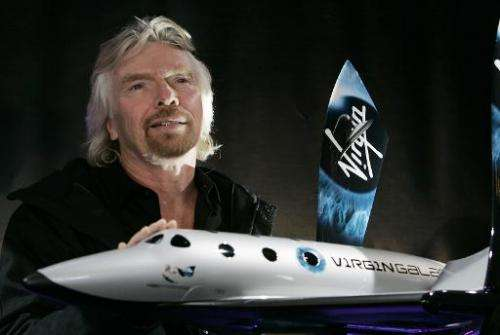 Sir Richard Branson, founder of Virgin Galactic, is seen with a model of the Spaceship Two at the American Museum of Natural His