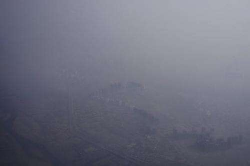 Smog covers buildings in the Indian capital New Delhi, on May 8, 2014