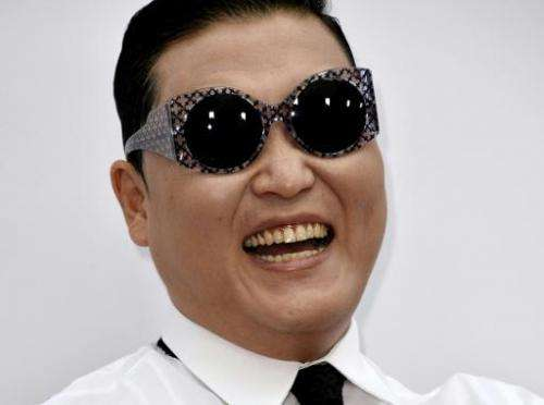 """South Korea's Psy attends the premiere of """"RED 2"""" at Westwood Village in Los Angeles, on July 11, 2013"""