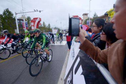 Spectators at the start of the second stage of the Tour of Beijing in Chongli town, near Zhangjiakou, in China's Hebei Province
