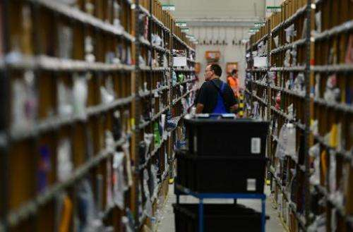 Storage shelves at a logistics center for US online retail giant Amazon
