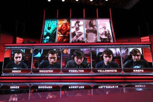 """Team members including """"Krepo"""" of the """"Evil Genius"""" team are seen on the screen during the live taping of th"""