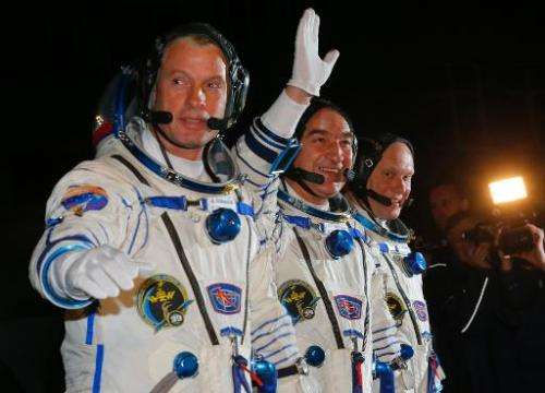 The crew members of a mission to the International Space Station (ISS), US astronaut Steven Swanson (L), Russian cosmonauts Alex