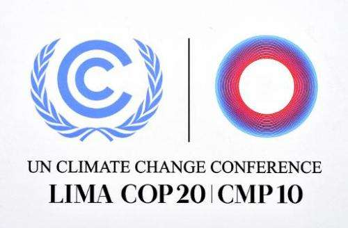 The official logo of the UN COP20 and CMP10 climate change conferences, on display at the venue in Lima, on December 5, 2014