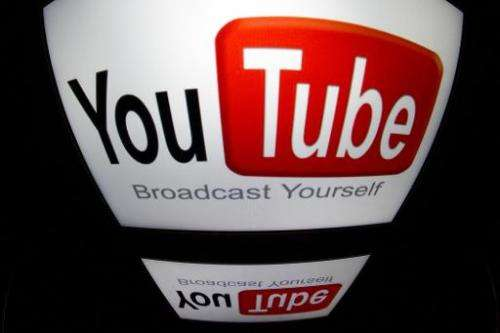 """The """"YouTube"""" logo is seen on a tablet screen on December 4, 2012 in Paris"""