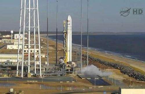 This NASA TV handout image shows an Orbital Sciences Corporation Antares rocket just moments before lifting off at NASA's Wallop