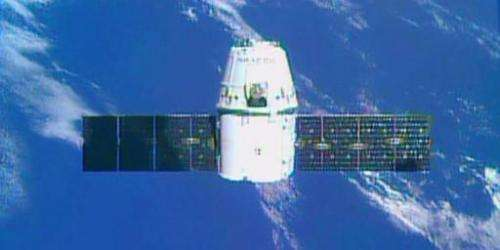 This NASA TV image shows the SpaceX Dragon private space freighter as it approaches the International Space Station on September