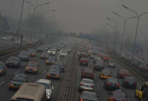 Traffic travels down the second ring road as heavy air pollution continues to shroud Beijing on February 26, 2014