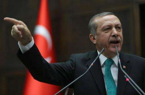 Turkey's Prime Minister Recep Tayyip Erdogan addresses members of parliament in Ankara on February 11, 2014