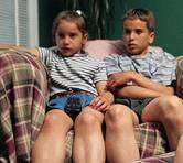 TV, computer time tied to heavier, less happy kids: study