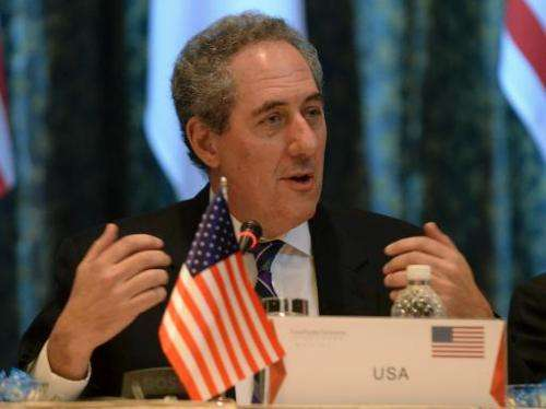 US trade representative Michael Froman speaks during a press conference in Singapore on February 25, 2014
