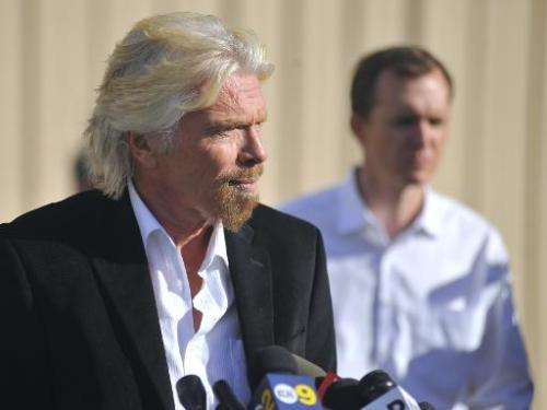 Virgin founder Sir Richard Branson speaks at a press conference at the Mojave Air and Space Port in Mohave, California on Novemb