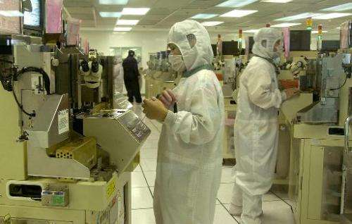 Workers at a unit of Cypress Semiconductor, which announced plans to merge with Spansion in a $4 billion deal bringing together