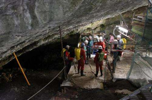 """Workers carrying out an excavation at the Atapuerca archaeological site prepare to go down to the """"Sima de los Huesos"""""""
