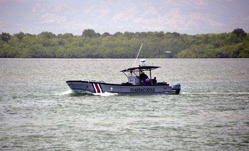 A Costa Rican coast guard boat monitors the beach in Puntaren on May 3, 2015
