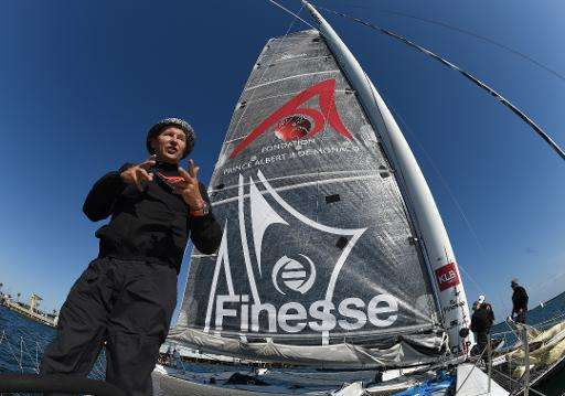 """Alain Thébault of France stands next to the """"Hydroptère"""" prior to attempting a record crossing from Los Angeles to Haw"""
