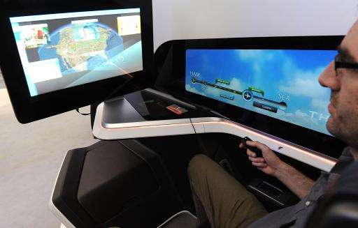 A visitor tries out French manufacturer Thales' prototype for the next generation of business class seat, which includes iris-tr