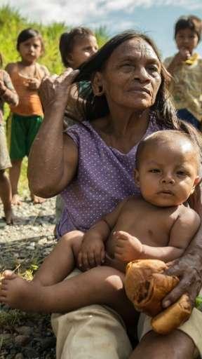 A Waorani indigenous woman holds a baby in Gareno, Ecuador