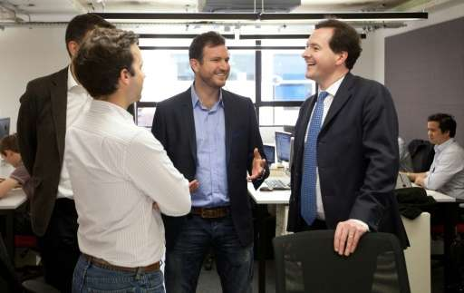British finance minister George Osborne (right) joined entreprenuers at the opening of the first campus in London in 2012