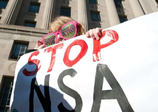 Civil liberties activists hold a rally against surveillance of US citizens at the Justice Department in Washington on January 17
