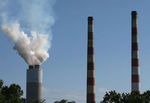 Emissions spew out of a large stack at a coal-fired generating station on June 29, 2015 in Newburg, Maryland