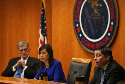 Federal Communications Commission Chairman Tom Wheeler (L), Commissioner Jessica Rosenworcel, and Commissioner Michael ORielly v
