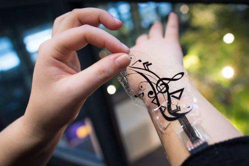 Flexible sensors turn skin into a touch-sensitive interaction space for mobile devices
