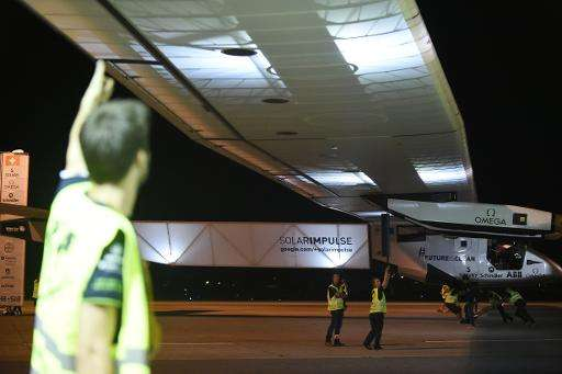 Ground staff prepares Solar Impulse 2 at Nagoya airport early June 24, 2015
