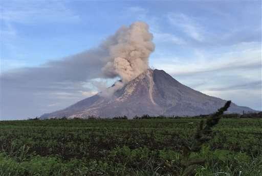 Indonesia volcano at high alert level unleashes fresh burst