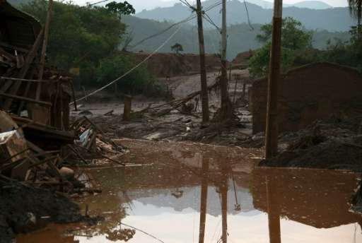 Partial view of mud-covered Bento Rodrigues, three days after an avalanche of mud and mining sludge buried the town in southeast