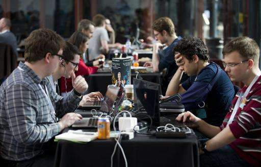"""Participants work on laptops as they take part in a """"Battlehack"""" competition in London on April 25, 2015"""