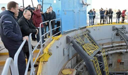 Russian President Vladimir Putin (2L) and Russian Space Agency (Roscosmos) head Igor Komarov (L) visit the construction site of