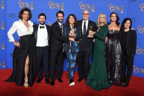 Actor Jeffrey Tambor (4th right) and show creator Jill Soloway (4th left) with the award for Best TV Series, Comedy or Musical f